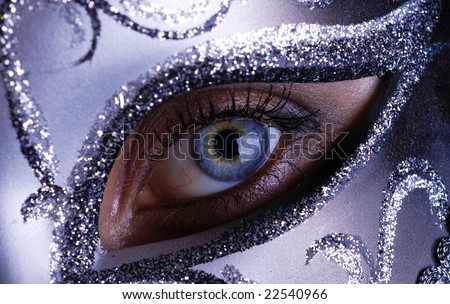 Blue eye with silver mask