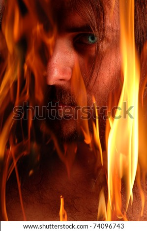 Blue eyed demon in flames