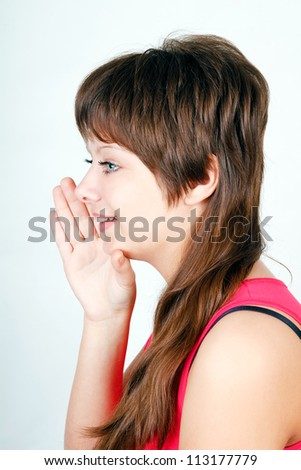 blue-eyed girl says something in secret behind his hand