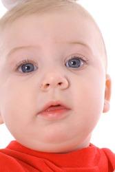 blue eyed infant baby upclose