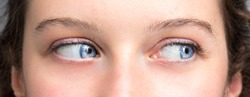Blue eyes of woman looking at the side