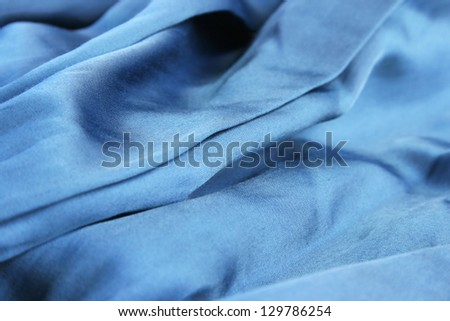 Blue fabric as a background.