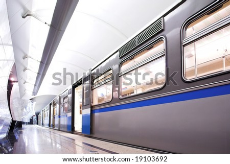 Blue fast train stay at hall platform