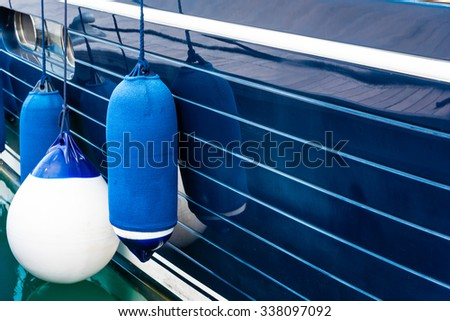 blue fenders on a boat #338097092