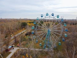 Blue Ferris wheel in the park of the 30th anniversary of the Komsomol in Omsk. Ferris wheel from above