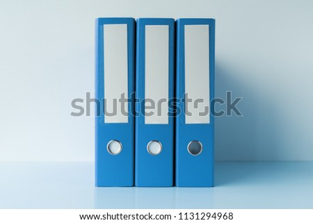 Blue file document ring binders in accountant and bookkeeping business office