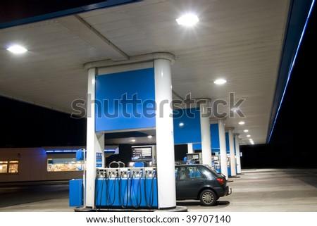 Blue filling station at night
