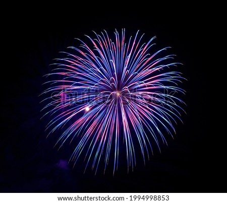 Blue fireworks in dark background, Malta fireworks festival,4 of July,Independence day, explode,blue purple violet fireworks isolated in dark background with the space for text.Fireworks in Mqabba jun