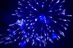 Blue fireworks in the night sky. Festive firecracker. Beautiful background.