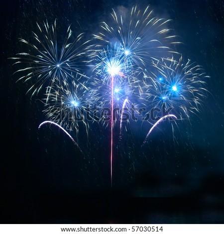 Blue fireworks on the black sky background
