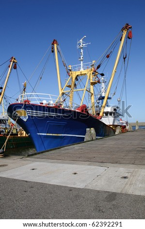 blue fish trawler in the harbor