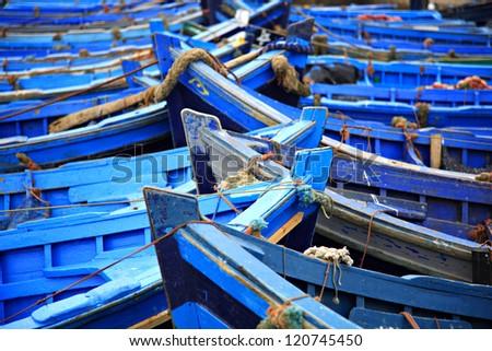 Blue fishing boats Essaouira harbor Morocco