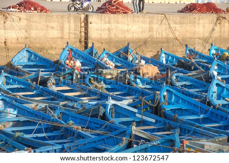Blue fishing boats in port of Essaouria, Morocco - stock photo