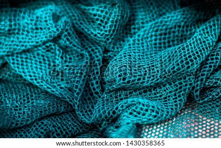 Blue Fishing net background,  Fisherman hunting net rope texture / pattern net.
