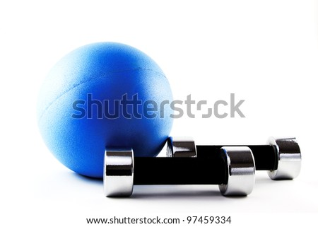 Blue fitness ball with silver hand weights in lying position