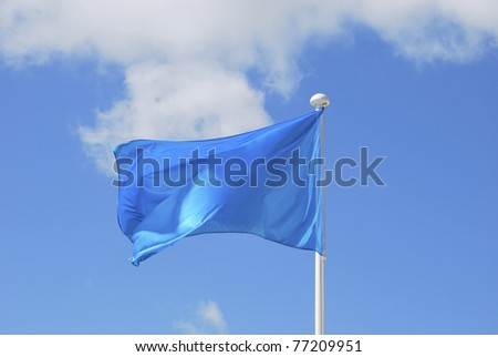 Blue flag waving over the sky. Promotional and advertisement object