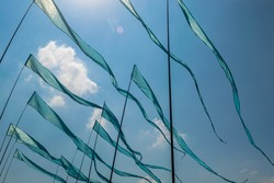 Blue flags waving in the wind at kite festival in Moscow