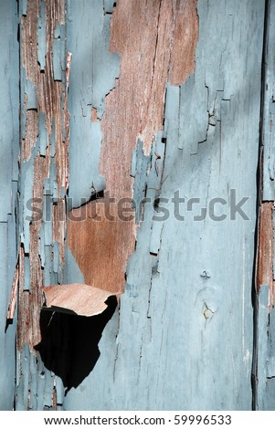 Blue flaky paint on a wood