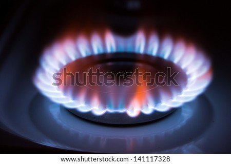 Blue flame gas stove in the dark.