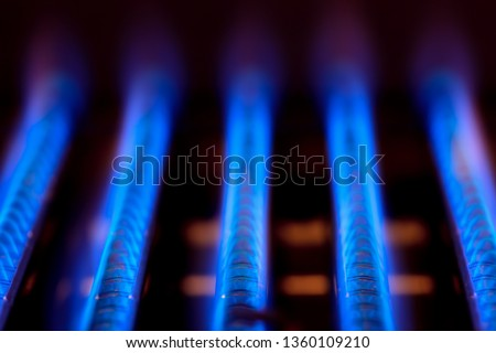 Blue flames of natural gas burnning inside of a boiler furnace - fossil fuel use concept ストックフォト ©