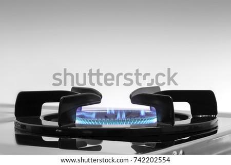 Blue flames on gas stove burner Foto d'archivio ©