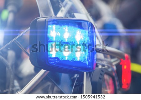 Blue flashing light on police motorcycle, arriving at the scene of accident and incident #1505941532