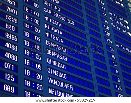 Blue flight information board in airport, selective focus.