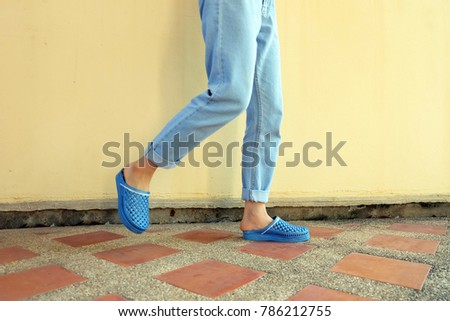 5c3224692890 Blue Flip Flops Fashion. Woman Wear Blue Sandals and Blue Jeans Stand on  the Tile