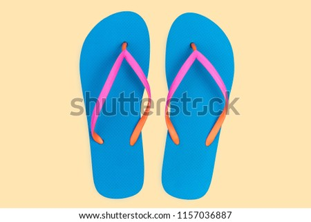 cbd668a9cb6ff8 Blue flip flops isolated on yellow background. Top view