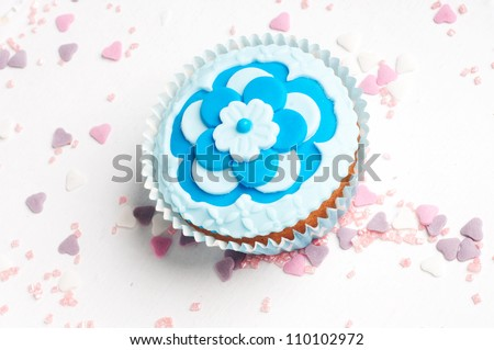 Blue flower cupcake with pink and purple sugar hearts