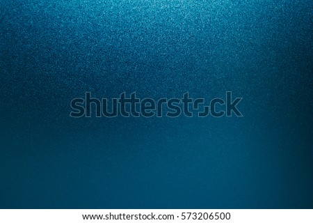 Blue foil background texture and Silver shiny shimmer metal wall, with glitter and sparkle for christmas paper card and paillette glow or glamour dark navy color, Abstract bright light or sequin.