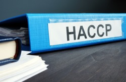 Blue folder with documents HACCP Hazard Analysis and Critical Control Points.
