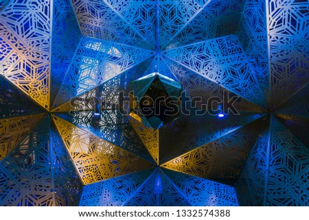 Blue fractal art installation with hanging mirror. #1332574388