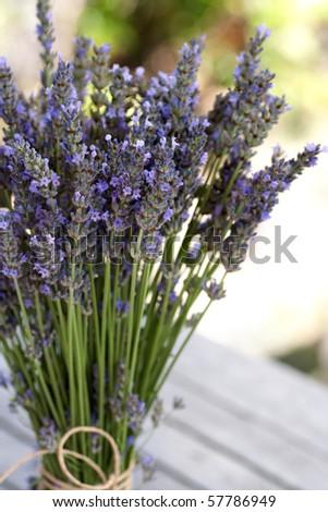 Blue fresh lavender bouquet on a wooden table