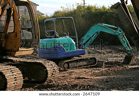 Blue Front End Loader on a muddy job site