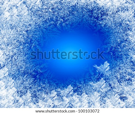 Blue frost winter background with white snowflakes