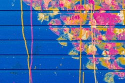 Blue Garage Wall with Pink, Yellow, and Orange Spray Paint Design in London, England