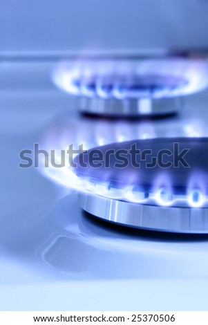 Blue gas flame on hob and space for text on left