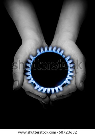 blue gas in hands on the black
