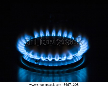 Blue gas stove in the dark - stock photo
