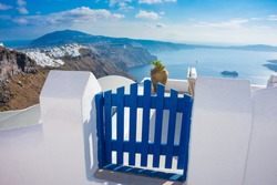 Blue gate overlooking sea and caldera at Santorini island, Greece