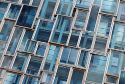 Blue geometric windows of modern building