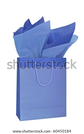 Blue gift bag with tissue paper isolated on a white background
