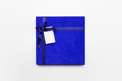 Blue Gift Box with ribbon  and name Tag isolated on white background.High resolution photo.