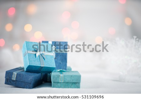 Blue gift boxes on the white fur with copy space for season greeting Merry Christmas or Happy New Year. #531109696