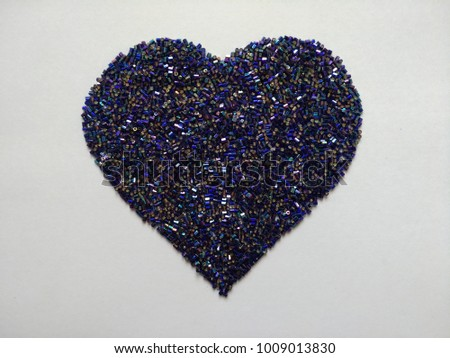 blue glass beads on heart shaped - Shutterstock ID 1009013830