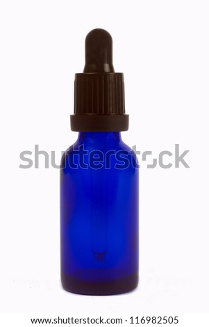 blue glass bottle of  Essential oils
