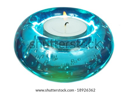 Blue glass candlesticks width lightening candle isolated on white background