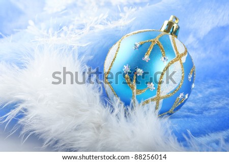 Blue glass Christmas balls on a  furry background,