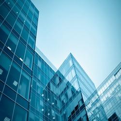 blue glass modern business center at night